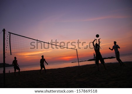 Beach volleyball in silhouette - stock photo