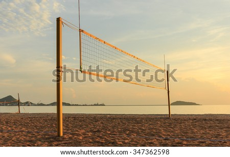 beach volleyball  net on sandy beach in the evening time - stock photo