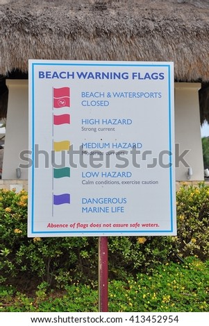 Beach warning flags sign - stock photo