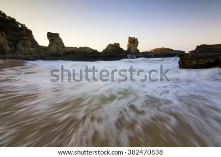 Beach water motion seascape sunrise at Klayar beach, Indonesia - stock photo