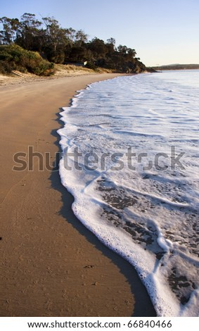 Beach Waves Roll In On A Swansea Morning Tide, Taken Tasmania, Australia - stock photo