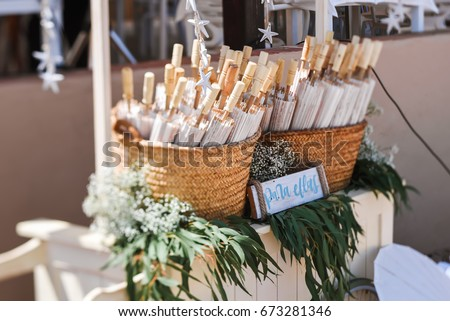 Beach wedding decoration details on sand stock photo 673281346 beach wedding decoration details on sand set of little umbrellas with spanish phrase para ellas junglespirit Gallery