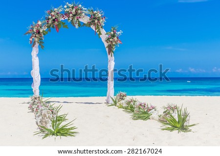 beach wedding venue, wedding setup, cabana, arch, gazebo decorated with flowers, beach wedding setup - stock photo