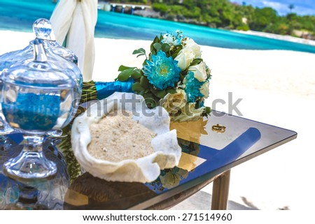 beach wedding venue, wedding setup, cabana, arch, gazebo, wedding bouquet - stock photo