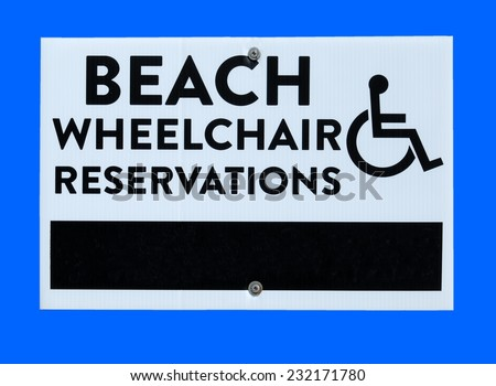 Beach wheelchair for rent sign - stock photo