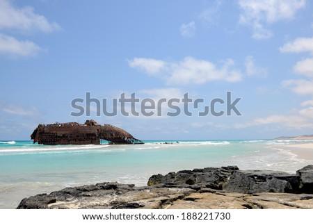Beach with a ship Wreck in Cabo de Santa Maria, Boa Vista Island in Cape Verde - stock photo