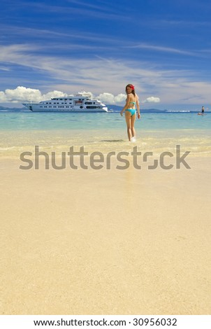 Beach with attractive young woman on Huahine island, French Polynesia