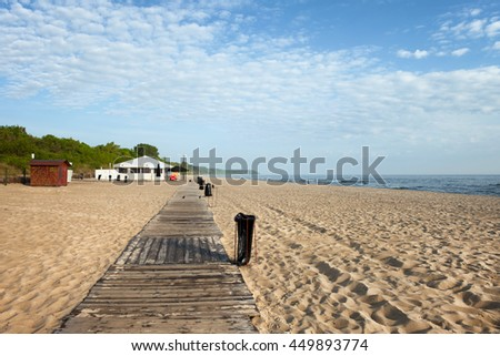 Beach with boardwalk in resort town of Wladyslawowo in Poland at Baltic Sea, popular vacation destination - stock photo