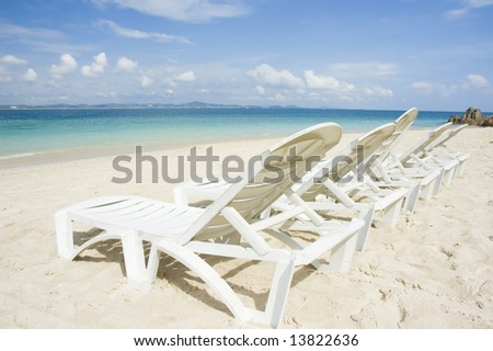 beach with chairs - stock photo