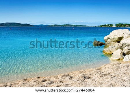 Beach  with clear crystal water and blue sky - stock photo