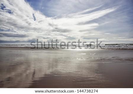 Beach with cloudy blue sky in Agadir at the Atlantic coast, Morocco. - stock photo