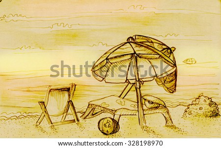 Beach with deck chairs, umbrellas, sand castles and sun lounger - stock photo