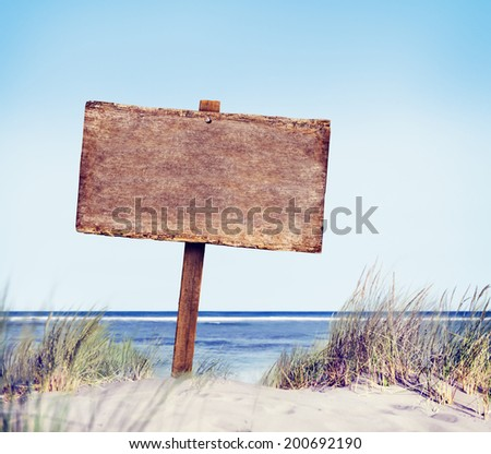 Beach with Empty Plank Sign - stock photo