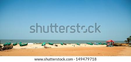 beach with fishing ships - stock photo