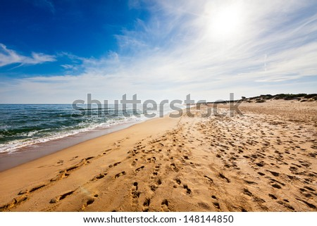 Beach with lots of footprints - stock photo
