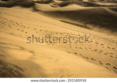 beach with marks - footprints in sand dunes - Grand Canaria - stock photo
