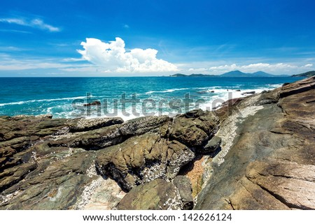 beach with rocks and blue sky at Rayong, Thailand