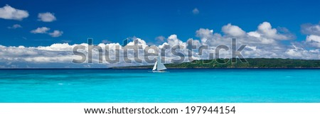 Beach with sailboat in ocean, Philippines - stock photo