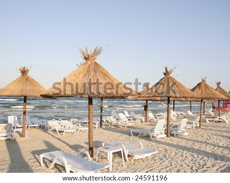 Beach with sunbeds and umbrellas.