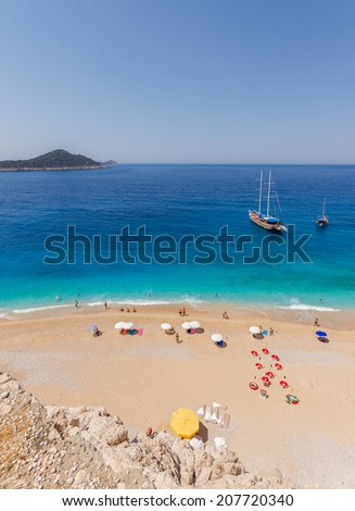 Beach with Tourists and Yachts.  - stock photo