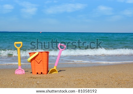 beach with toys summer scene - stock photo