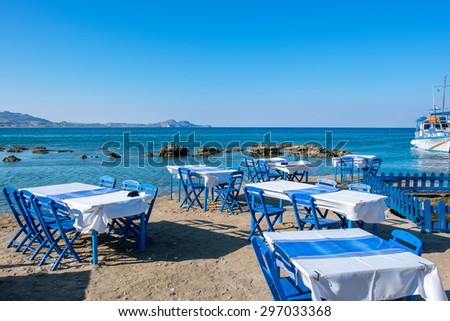 Beach with traditional blue tables and chairs. Kolymbia. Rhodes, Greece - stock photo