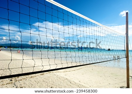Beach with volleyball net in Boracay Island in the Philippines. - stock photo