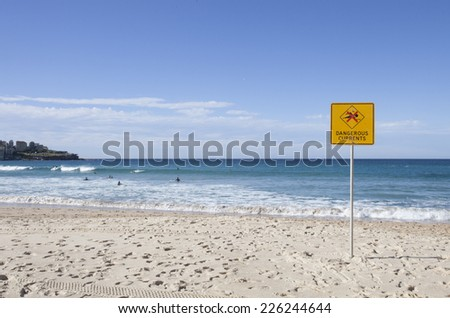 Beach with warning sign on it - stock photo