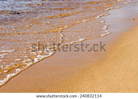 beach with wave on the island La Maddalena in Sardinia - stock photo