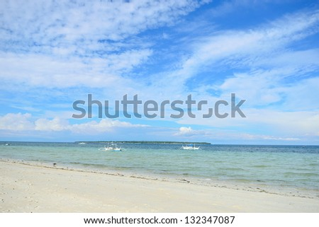 Beach with white sand and blue skies