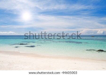 beach with white sand and sea
