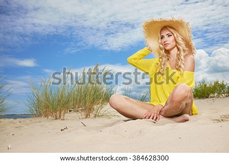 Beach woman funky happy and colorful wearing  beach hat having summer fun during travel holidays vacation.