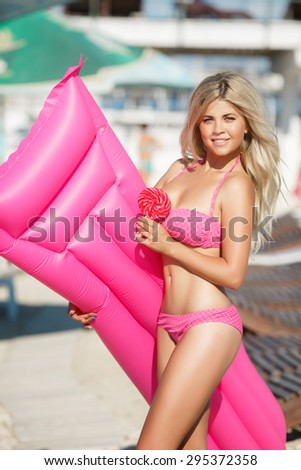 Beach woman sexy girl bikini model at pool, glamour blonde female in swimsuit relaxing at beach, vogue style model in swimwear, happy lady summer vacation portrait, girl in pink bikini outdoors - stock photo