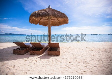Beach wooden chairs for vacations and summer getaways in Boracay - stock photo
