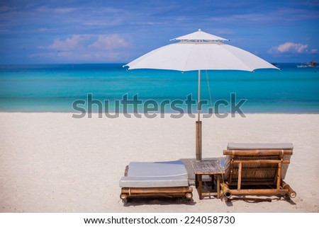 Beach wooden chairs for vacations on tropical beach