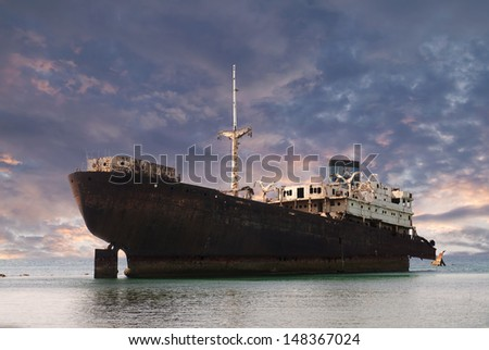 beached boat in Spain - stock photo