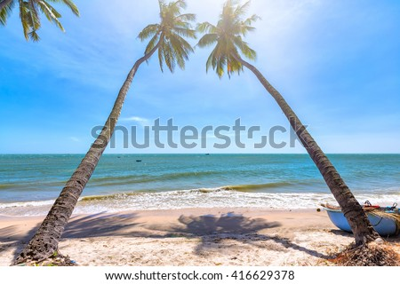 Beachside coconut sunny summer day at shore Phan Thiet with gentle but feels peaceful, fun for the weekend in Binh Thuan, Vietnam - stock photo