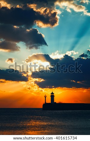 Beacon at sunrise, a view from the central city embankment, Crimea