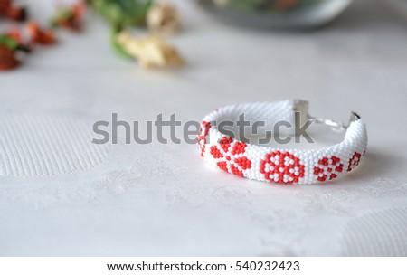 Beaded crochet bracelet with floral print close up