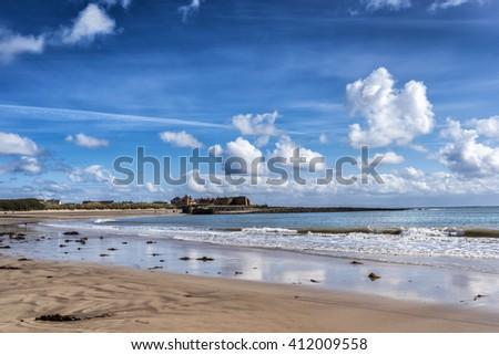 Beadnell beach on the Northumberland coast in England - stock photo
