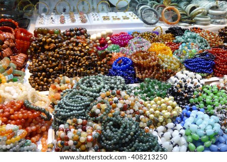 Beads, bangles and necklaces for sale   in the central market of  Yangon (Rangoon),  Myanmar (Burma) - stock photo