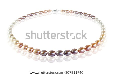 Beads of colored pearls with reflection - stock photo