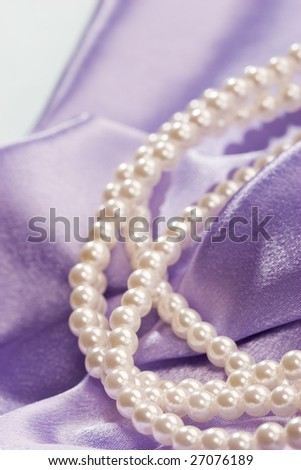 Beads of pearl on the lilac for lady