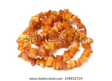 Beads of precious stones on a white background - stock photo