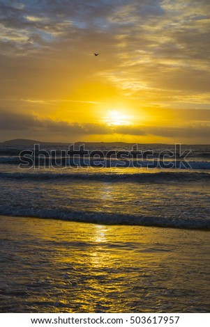 beal beach near ballybunion on the wild atlantic way ireland with a beautiful yellow sunset