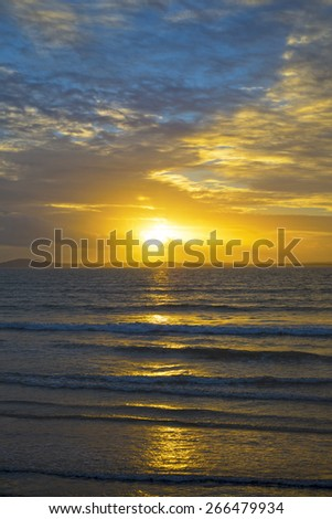 beal beach near ballybunion on the wild atlantic way ireland with an orange sunset - stock photo