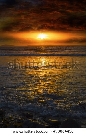 beal beach near ballybunion on the wild atlantic way ireland with an orange sunset