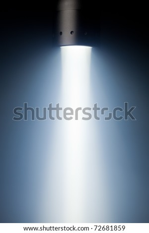 beam of defuse light in the fog - stock photo