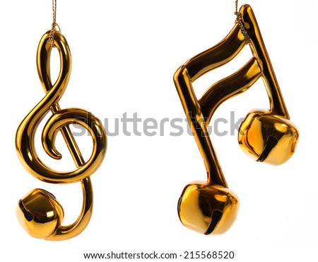 Beamed sixteenth note, and treble clef jingle bell Christmas ornaments isolated on white background.   - stock photo