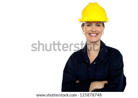 Beaming construction worker wearing yellow safety helmet. Cheerful portrait - stock photo